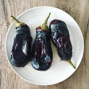 Burnt fire-cooked aubergines