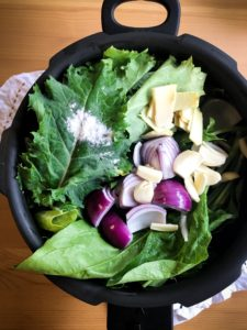 30-Minute Saag Paneer: Mustard greens, spinach and aromatics before cooking